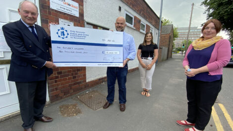 Philip Seccombe presents a giant cheque to the Futures Unlocked team